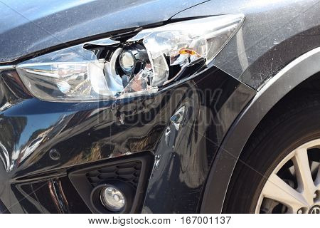 Auto car headlight smashed from a crash