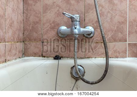 faucet with lime deposit calcified water and tiles with fungi moisture problem