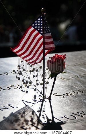 American flag and rose at the 911 memorial world trade center, New York