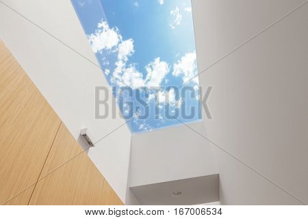 Hallway with a big skylight on a Sunny Day
