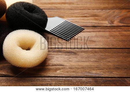 Accessory for hairstyle on wooden background