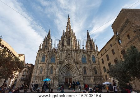 Barcelona Spain - January 02 2017: Some people are walking on the square of the Gothic church located in a gothic quarter of the city
