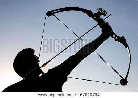 Archer Draws His Compound Bow Silhouette