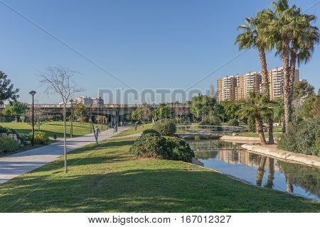 Turia River gardens Jardin del Turia, leisure and sport area. Pedestrian walk way and artificial water channel. Valencia, Spain