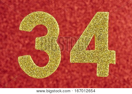Number thirty-four yellow color over a red background. Anniversary.