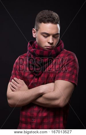 Young Man Dissatisfied Looking Down