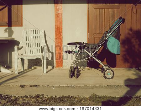 Stroller on classic home background,Stroller in vintage style.