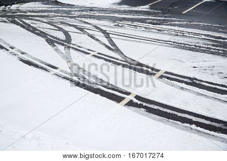 tire track on the snow in the parking area