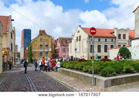 KLAIPEDA LITHUANIA - JULY 11 2015: Unidentified tourists visit landmarks on street of Old Town in Klaipeda
