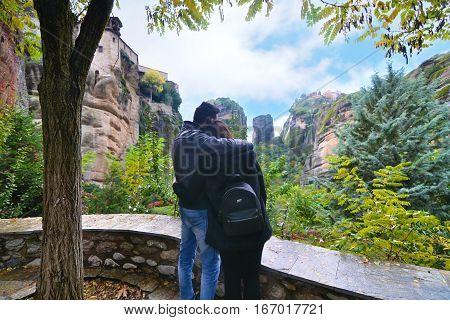 METEORA GREECE, OCTOBER 29 2016: couple in love looking at the huge rocks of Meteora Greece. Editorial use.