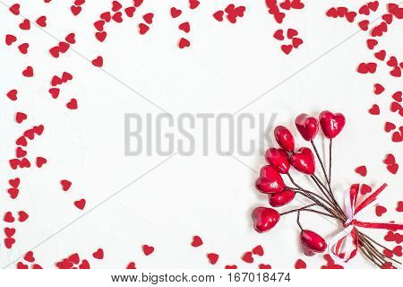 Elegant festive background with decorations in the form of heart on white textured surface with space for text. The mood of tenderness and love. Symbols of Valentines Day