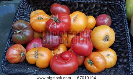 Variety of heirloom tomatoes at a farmer's market