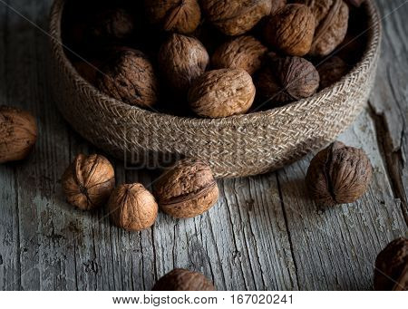 Group of nuts on low key on wooden table