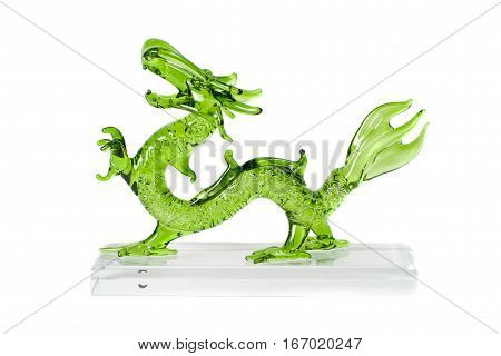 Glass green traditional chinese dragon isolated on white background. Feng Shui statuette.