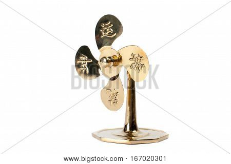 Golden traditional chinese fan isolated on white background. Feng Shui statuette.
