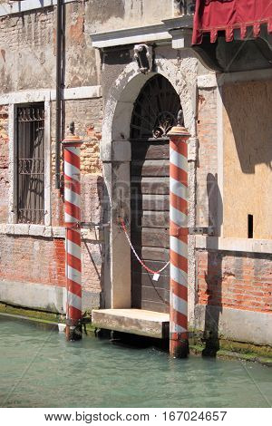Typical entrance door of a renaissance palace in Venice, Italy