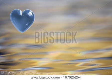 Blue Heart with soft focus water reflections