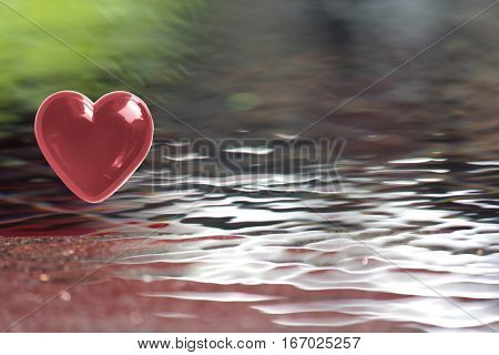 Burgundy Brown Heart with soft focus water reflections