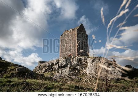 Smailholm Tower stands on a rocky crag in the Scottish Borders