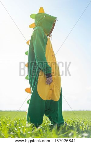 Dragon kigurumi on the green fild, girl