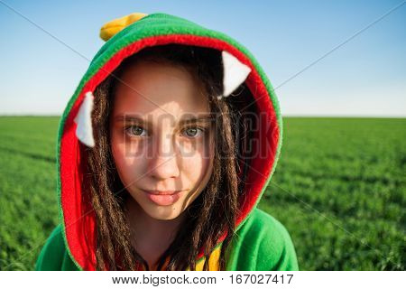 Dragon kigurumi on the green fild, girl, portrait