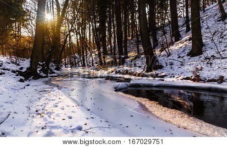 Ice on the river illuminated by the setting sun. Moravian landscape Pilske udoli.