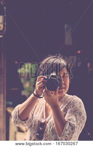 Asia Woman Take A Photo By Camera