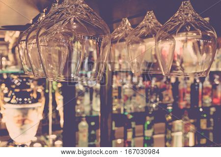 Whiskey glass defocus on Bottles of whiskey at the bar background process in vintage style