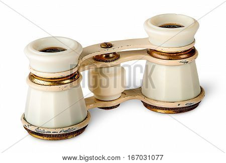 Old vintage pair of opera glasses vertically isolated on white background