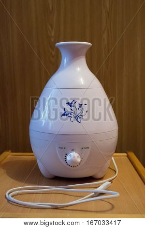 humidifier device for humidifying the air smoke electric on wooden table