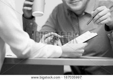 Black and white photo of people working in office
