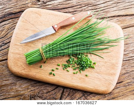 Green onion on the wooden table.