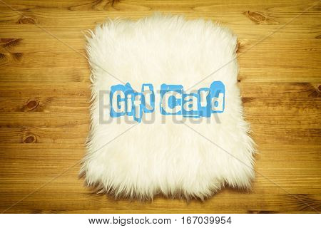 Gift Card. Decorative fur carpet on wood floor background