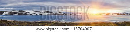 Panoramic Shot Of Beautiful Sunrise Scene Over Mountain And Fjord, Winter Landscape In Norway