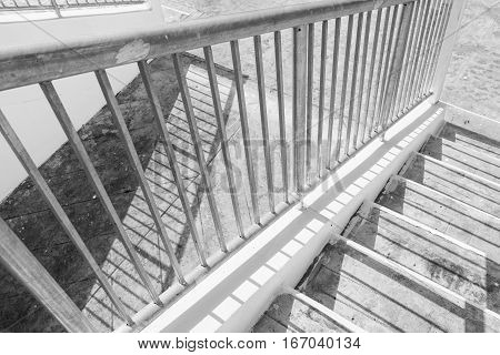 stair concrete and steel handrail with shadow.