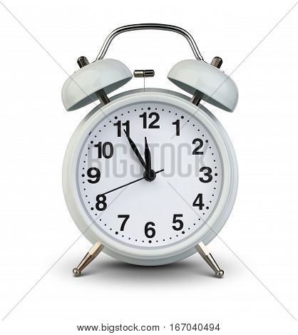 Alarm clock isolated on white with clipping path five minutes to twelve