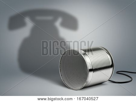 Tin can with telephone shadow communication concept