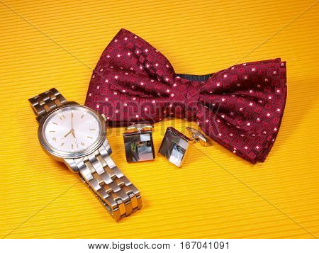 Red bowtie pearl cufflinks and faschinable watch