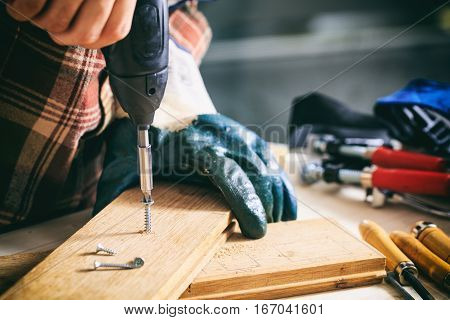 Carpenter Working With An Electric Screwdriver