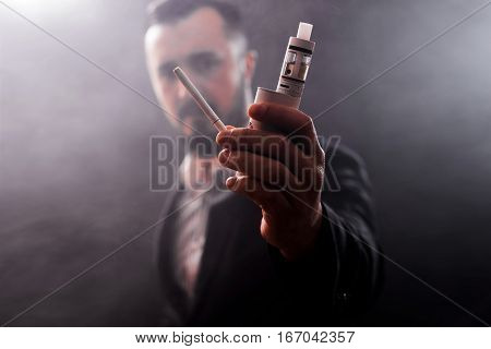 Concept Of Choosing The Type Of Cigarette, Close Up Of A Smoker Undecided About Choosing The Type Of
