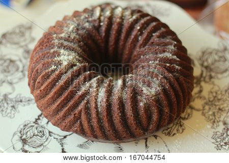 This is a view of a pumpkin spice bundt cake with powdered sugar