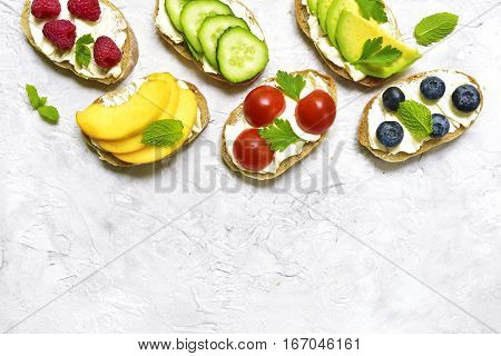 Assortment Of Fruit And Vegetable Toasts.top View With Space For Text.