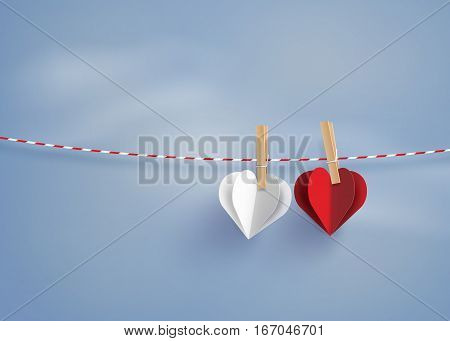 paper heart shape hanging on the lope with blue sky.paper art style.