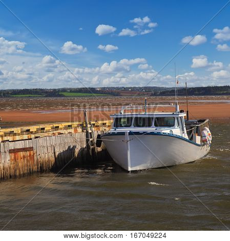 Lobster boat tied up at a wharf in Rustico, Prince Edward Island, Canada.