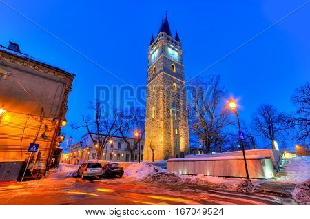 Traditional architecture of the famous tower of Iancu de Hunedoara, illuminated at night - Baia Mare - Romania