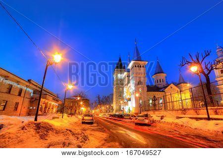 Beautiful winter scene in Baia Mare city with illuminated architecture at night, Romania