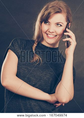 Flirt and romance. Begin of relatinship. Attractive blonde woman flirting texting on mobile phone smartphone. Gorgeous girl keep in touch with her lover by messages and calls.