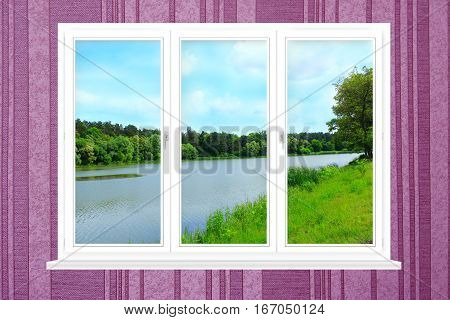 plastic window with view to summer landscape with forest and lake