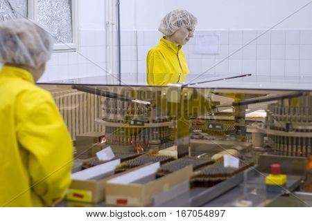 Medical Vaccine Manufacturing. Female workers at pharmaceutical factory.