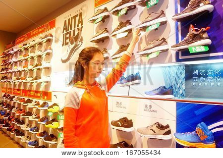 Shenzhen, China: January 27th, new year's Eve, women buy shoes and other goods in sports clothing store. In Shenzhen, china.